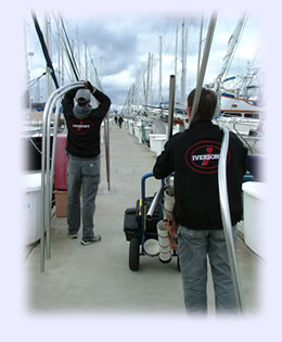 Carrying a stainless steel frame to the sailboat. Click to enlarge photo.